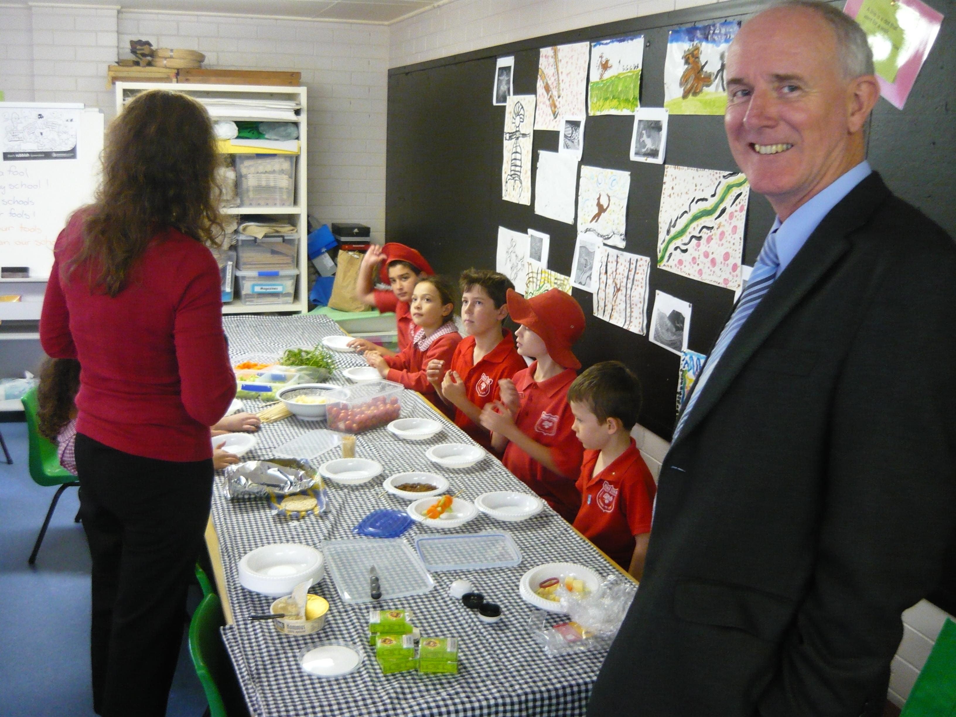 Children use the produce from the garden in a Kitchen Lesson.